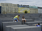 Tourists posing at Peter Eisenman's Holocaust Memorial in Berlin. Photo: Stefan Weidner © Goethe-Institut