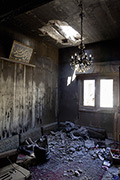 Living room destroyed by a shell from the government forces in Syria. Photo: Kai Wiedenhöfer © Goethe-Institut