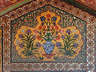 Bat, owl, or other bird of prey with spread wings. This motif, recurring with slight variations, is found above the vase pictures in the passageways