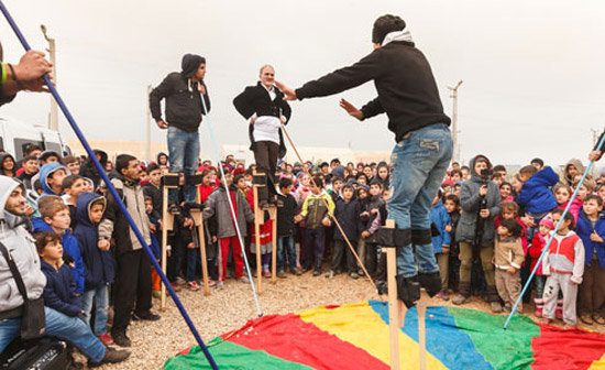 Young and old watch the demonstration at Camp Nusaybin with enthusiasm