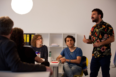 Ahmet Öğüt (founder of Silent University), Sherko Jahani Asl (lecturer of Silent University Stockholm), Vera Grugel (assistant of Silent University) at Impulse Festival 2015 (f.r.t.l.); photo: Robin Junicke