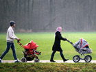 Syrian refugees going for a walk on a village street in Bavaria. Photo: Achim Wagner