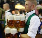 A waiter with beer mugs. Photo/Copyright: Benassi