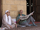 Man reading a newspaper, Al-Azhar Mosque, Cairo. Photo: Markus Kirchgessner