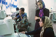 Young woman chatting online. Internet Café Mogadam, Tajrish Square, Tehran. Photo: Markus Kirchgessner