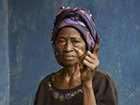 Woman showing the ink on her finger as proof she has voted on election day in Pujehun, Sierra Leone. Photo: Kelly Fajack, Getty Images © Goethe-Institut