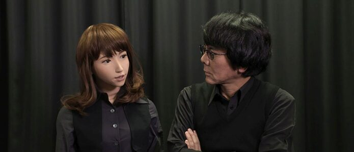 AI-driven robot ERICA talks with her inventor Hiroshi Ishiguro