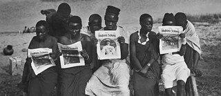 "Racism – German East Africa: Indigenous people reading the ""Berliner Illustrierte Zeitung"" (BIZ)"