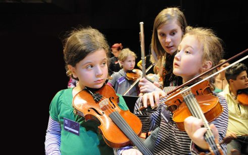 The children-play-yourself orchestra exploring Prokofiev's 'Peter and the Wolf' at the Festspielhaus Baden-Baden.