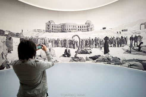 Documenta visitor in front of a work of Goshika Macuga;