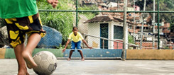 Brazil is unthinkable without football: Kids kicking in a favela.