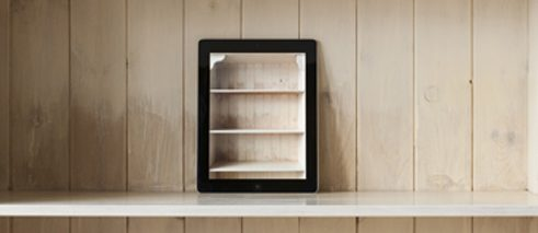 iPad on an empty bookshelf