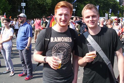 "Not everyone was wearing a Germany ""home jersey"" that day or a black-red-and-gold garland. ""Only the time of day shouldn't be shown in the picture,"" say football fans Sebastian and Micha, as it's pretty early for a beer."