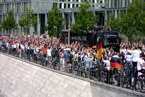 In the meantime, the open-top trailer carrying the national team inches its way forwards into the centre of Berlin, where the route from the airport is lined with thousands and thousands of cheering fans.