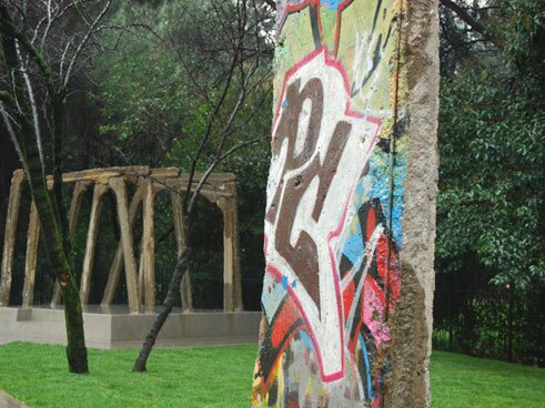 "Since 2013, one segment of the Berlin Wall has been part of the ""Post-Bloc"" complex of buildings in Tirana;"