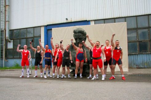 "Athletes - Polish weightlifters – lift Willy Brandt Statue in Warsaw as part of the premiere of Christian Jankowski's project ""Heavy-weight History"", presented in the exhibition ""Heavy-weight History"" at the Centre for Contemporary Art Ujazdowski Castle until August 25th, 2013"