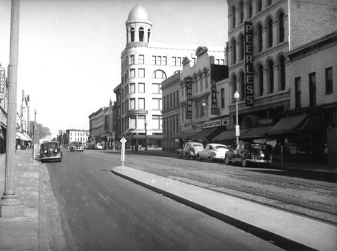 East Side of 7th Street Looking North from H Street NW. The street as it looked on October 23, 1949. Julius Germuiller's building at 819-821, once Grogan's Furniture, has become Peerless Furniture by 1949.