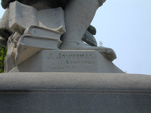 The base of the statue of Benjamin Franklin contains the name of the German-born sculptor, Jacques Jouvenal. (2000)