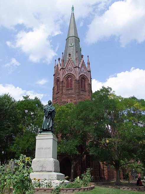 The statue of Martin Luther by Ernst Rietschel stands prominently in front of Luther Place Memorial Church, 2000.