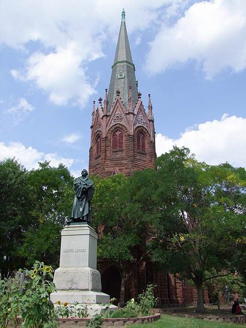 The statue of Martin Luther by Ernst Rietschel stands prominently in front of Luther Place Memorial Church, 2009.