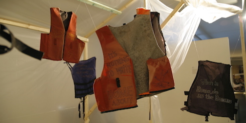 An installation with embroidered life vests by the German artist Birgit Rüberg
