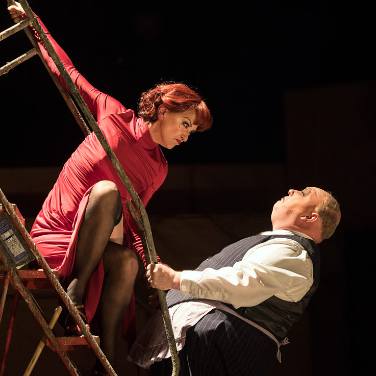 Haydn Gwynne (Mrs Peachum) and Nick Holder (Mr Peachum)