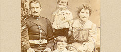 Walter Harrington as a small child, with Minnie his mother, father Michael and older brother Albert, seated below him
