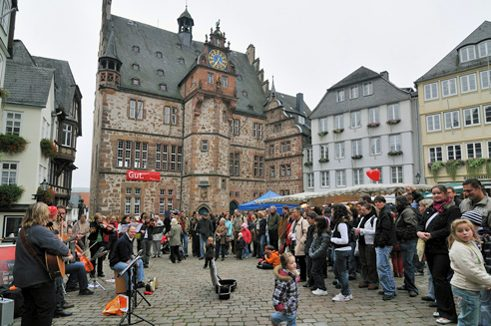 Town hall and market place with musicians
