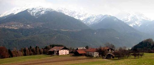 a farm, background: snowcapped mountains