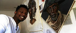 "Loyiso Mkize was commissioned to paint a series of artworks from the Holywood movie ""Momentum"", whcih was shot in Cape Town, and a cover from his ""Kwezi"" comic book"
