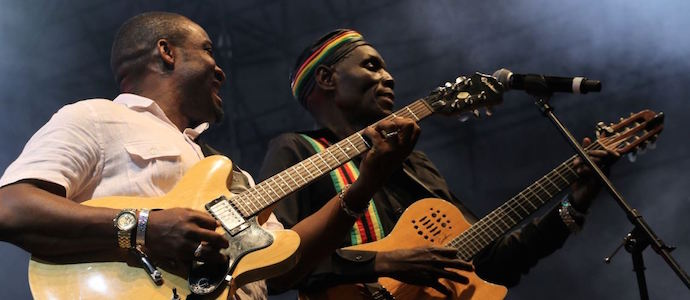 The musicians Kunle Ayo from Nigeria and Oliver Mtukudzi from Zimbabwe.