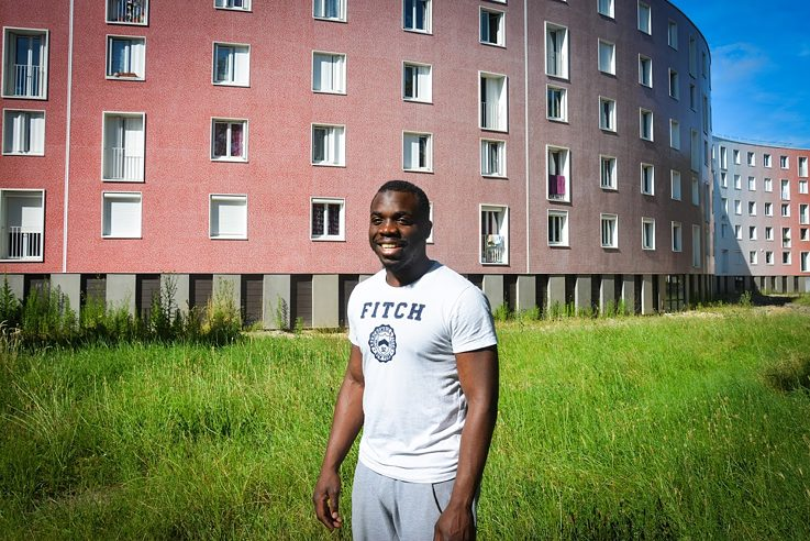"Kévin N'Gangu, 26, youth leader at the municipal youth club, in front of the ""Serpentin"""