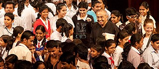School Children interacting with Astad Deboo and his troop after his work is presented at NCPA