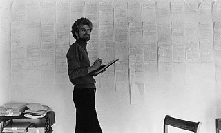 "Leonore Mau | Hubert Fichte in front of his notes on ""Attempt about the puberty"" 