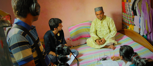 Ashraful Huq Babu is being interviewed by Amzad Hossain Dinar inside Geneva Camp in Dhaka: