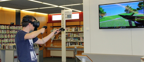 Library  visitors can learn about the possibilities of virtual reality by putting on VR glasses