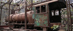 Abandoned G8 steam train fallen into disrepair in the ruins of the train station and factory in Riyaq