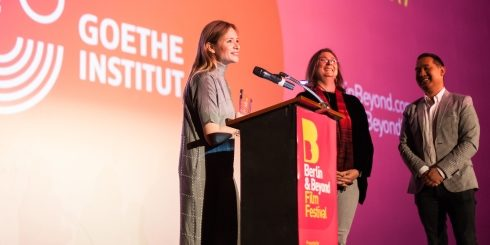 Sigrid Savelsberg, director of the Goethe-Institut in San Francisco, and festival director Sophoan Sorn with Julia Jentsch at the award ceremony at the Castro Theater.
