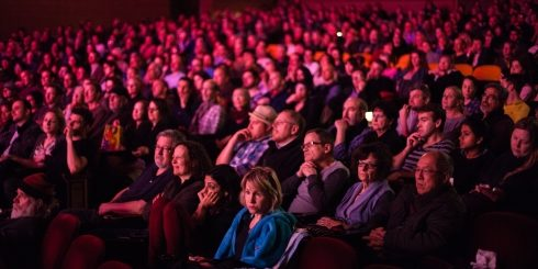 The audience at Berlin & Beyond are immersed in the programme in glowing festival pink.
