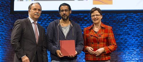The Award ceremony in Munich: Klaus-Dieter Lehmann, president of the Goethe-Institut, Abbas Khider and Uta-Micaela Dürig, manager of the Robert-Bosch-Stiftung.
