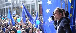 """Pulse of Europe"" founder Daniel Röder at one of the demonstrations for Europe, surrounded by blue balloons and flags in Frankfurt am Main"