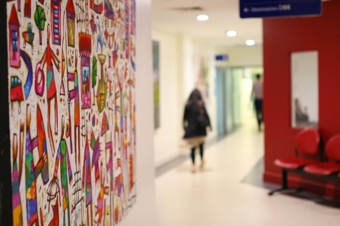 Hospital corridor as a gallery walkway with Australian artist Bruce Earles' works on display.
