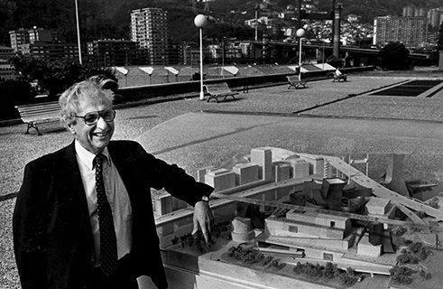 Frank Gehry, who designed the Guggenheim Museum Bilbao, with a model of his design