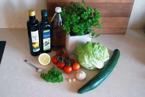 Syria: Fatoush, Arabic salad: Ingredients for 4 persons: 3 tomatoes, 1 cucumber, 1 iceberg lettuce, 2 garlic cloves, 2-3 mint leaves (or seasoning mix with mint), a couple of parsley stalks, 4 tbsp vinegar, 3 tbsp olive oil, juice of ½ lemon, ½ tsp salt, flatbread