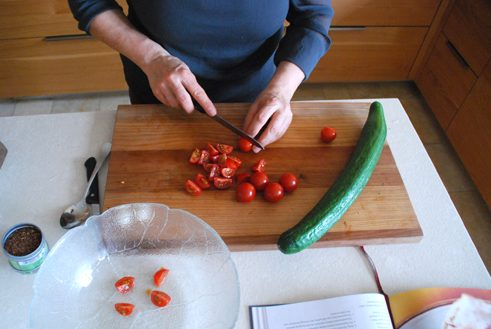 Wash and dice tomatoes and cucumber. Chop the garlic very fine or use a garlic press. Chop the parsley and mint.