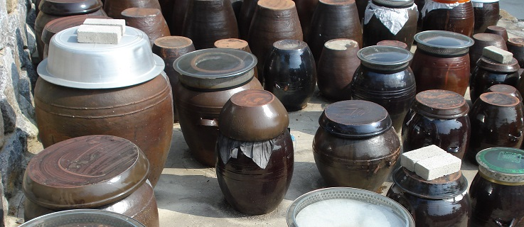 Onggi ceramic crocks filled with kimchi in Seoul, South Korea.