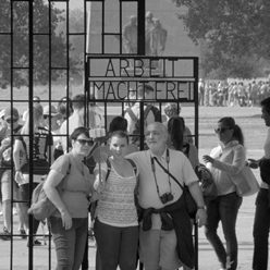 Tourists in front of a Nazi death camp.