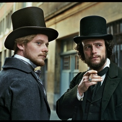 Two men wearing top hats.