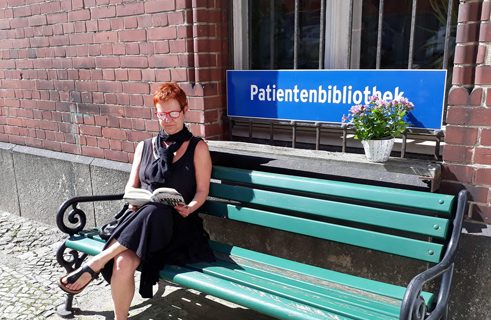 A popular reading place in fine weather - the bench in front of the patients' library