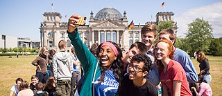 a GAPP group takes a selfie in Berlin in front of the Reichstag